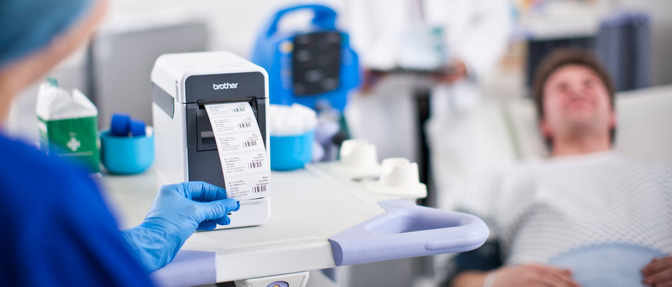 Brother label printer outputting, with nurse in blue uniform