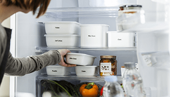 Labelled storage containers in a fridge