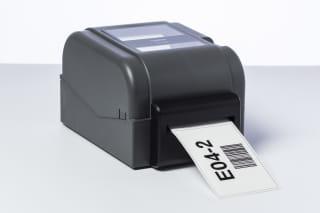 Kokonaan tai puoliväliin leikkaava PACU002-tarraleikkuri on asennettu TD-4T-tulostimeen